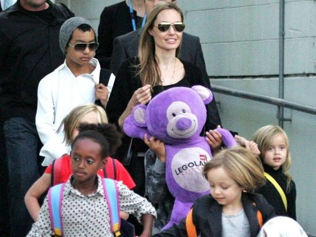Actress Angelina Jolie arrives at Sydney Airport with her children, Friday, September 6, 2013