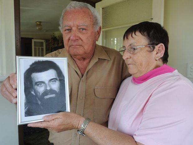 Bill and Jan Cross with a photo of Robert who went missing in 2006.
