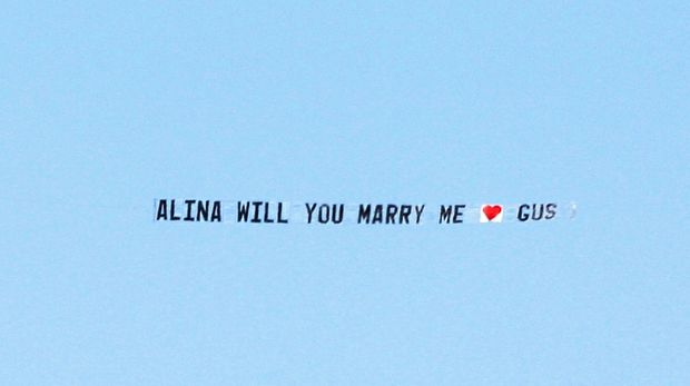 """PLANE dragging a sign, """"Alina will you marry me, Gus"""" flew over Point Cartwright."""