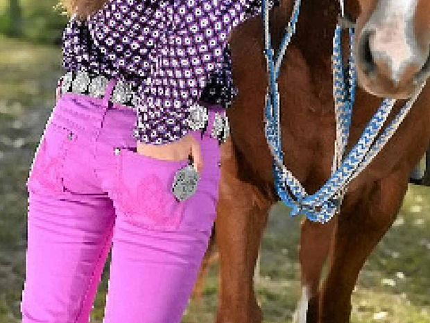 Barrel rider Grace Taylor rocks some booty up Wrangler Jeans ($89.95) with a Bling belt ($88) from Limestone Clothing.