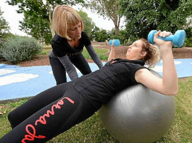 WINNING OBESITY BATTLE: Ipswich Hospital Foundation personal trainer Susan Yates helps Chelsea Rees with exercise.