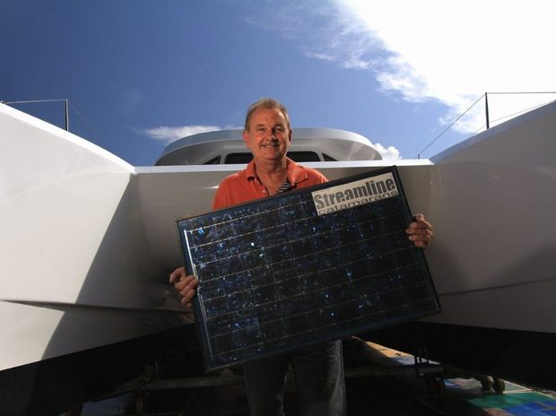 Project manager Wayne Jones with the first solar powered boat manufactured by hand in Hervey Bay.