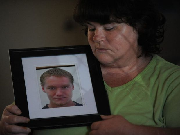 GRIEVING MOTHER: Helen Gordon with a portrait of her son Leonard Gordon who was allegedly murdered at the Maryborough Correctional Centre one year ago. Photo: Mike Knott / NewsMail