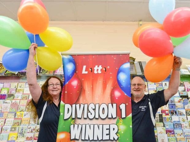 UP IN THE AIR: Joan and Allan Worland of Grafton Mall News put up the ballooons after selling a $1m winning Lotto ticket.