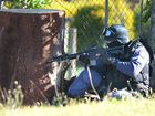 Police surround a house in Banora Point.
