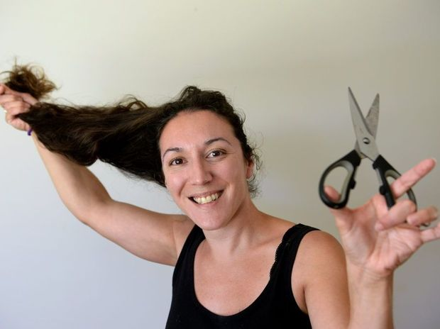 Yael Maree is collecting pony tail hair.