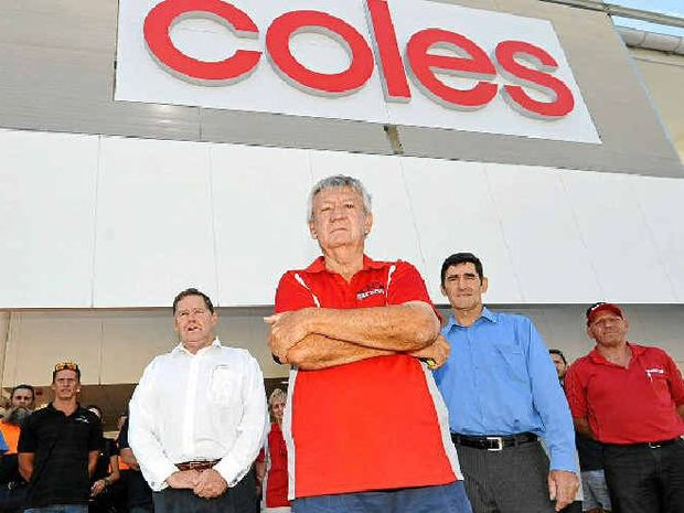HIT HARD: Sub-contractors owed money and Member for Nicklin Peter Wellington outside the new Coles in Nambour.