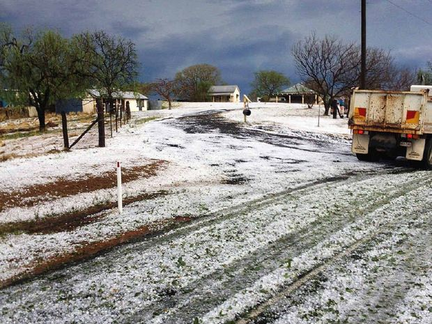 STORM SEASON: Hail creates a wintry scene at Woodlands Road in Gatton (above and inset).