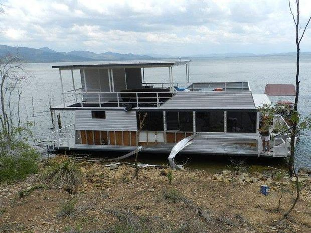 Lake Awoonga Boat Hire's fleet of boats, including the $200,000 43-foot Barra Queen, was damaged in wild weather.