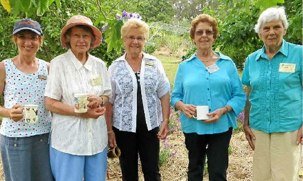 SHARED INTEREST: Robyn Bowman, Coral Ernst, Val Vidler, Val Deans and Mel Shaw standing beneath the potato tree in Dell and Henry Kross's garden at Wolvi.