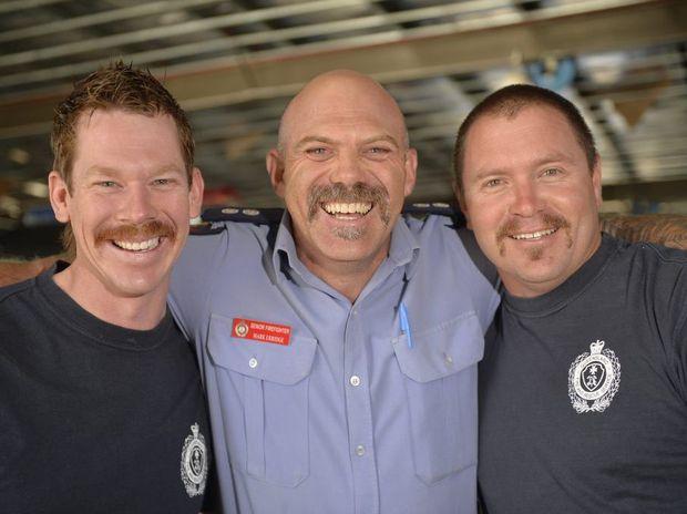 Aaron Sands, Mark Erridge, Brad Rosenblatt show off their Movember efforts.
