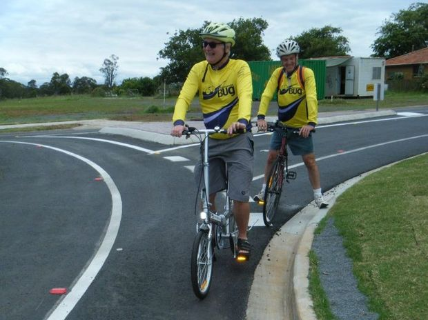 Toowoomba Bicycle Users Group members Hugh Wilson (front) and David Allworth ride the city's streets.
