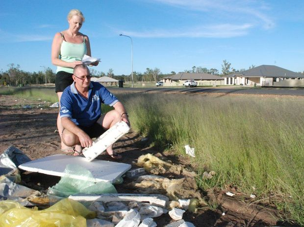 Janelle and Ray Duncombe are appalled at the rubbish piling up at their Racecourse Rd property.