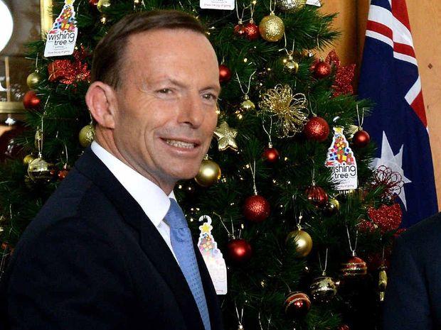 MOOD SWING: Tony Abbott needs to swap blue for yellow ties.