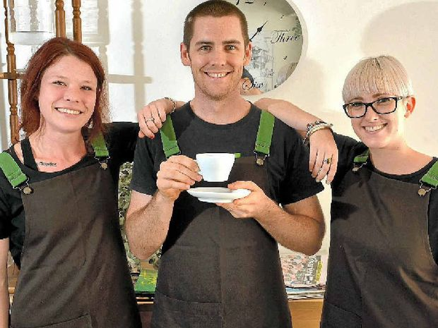 COFFEE BUZZ: Erin Martyn, James Pedrazzini and Tilly Sproule toast Lamkin Lane Espresso Bar's success in Beanhunter's list of top cafes for 2013.