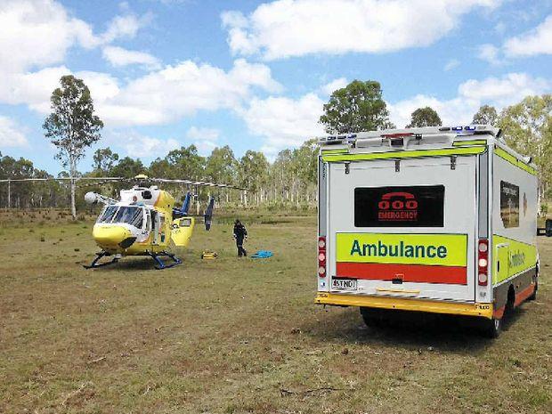 The RACQ CareFlight Rescue chopper on scene on Monday.