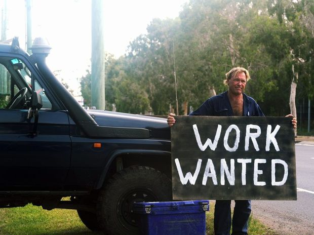 Guy Clark, 49, is so eager to find employment that he is advertising on the side of the road.