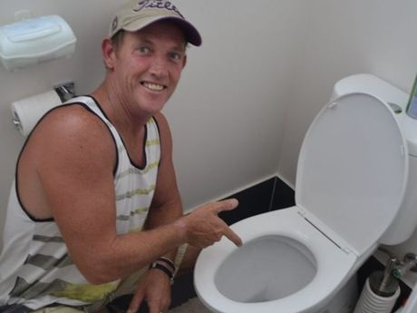 Chinchilla dad Dave Byrne was shocked when his daughter found a 1.2m brown snake in the family toilet.