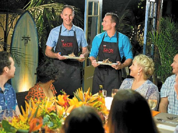 DYNAMIC DUO: The My Kitchen Rules 2014 Queensland team, teachers Paul, left, and Blair from the Gold Coast, plate up some dishes for their instant restaurant.