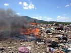 Lakes Creek Road Landfill reopened as fire smoulders