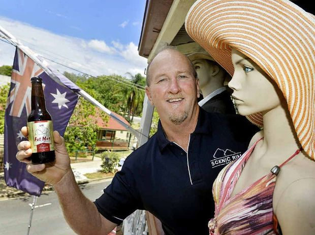 SOMETHING DIFFERENT: Mike Webster shows off his new beer with The Commercial Hotel's iconic mannequins at Boonah.