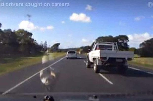 BAD BEHAVIOUR: A still from a car's dash cam video that captured a motorist dangerously merging in front of another vehicle while driving in Mackay.
