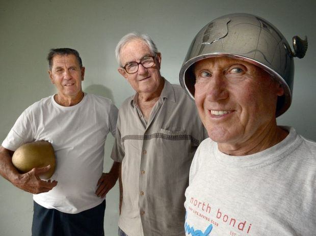 From left, Bob Trevan of Lismore, Bob Pilling of East Ballina, and Darcy Neill of Sydney. Mr Neill wears a helmet won by his father racing motorbikes at the Lismore Speedway, made by Mr Pilling's father, and commisioned by Mr Trevan's father.