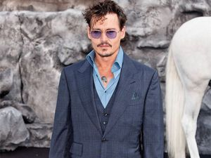 Depp source tries to blame bust-up on Cara Delevingne