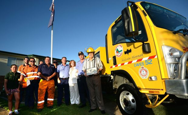 Malcolm Hannah with members of the Caves Rurual Fire Brigade. Photo Allan Reinikka / The Morning Bulletin