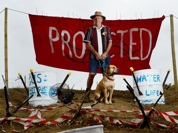 A protester stands in protest against CSG mining in Bentley.
