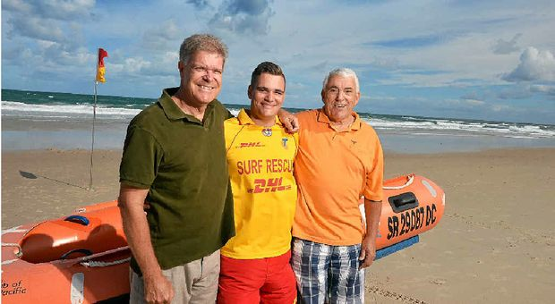 FAMILY HERO: Caloundra lifesaver Colton Pleass (centre) rescued his father Warwick and grandfather Kevin on Sunday.