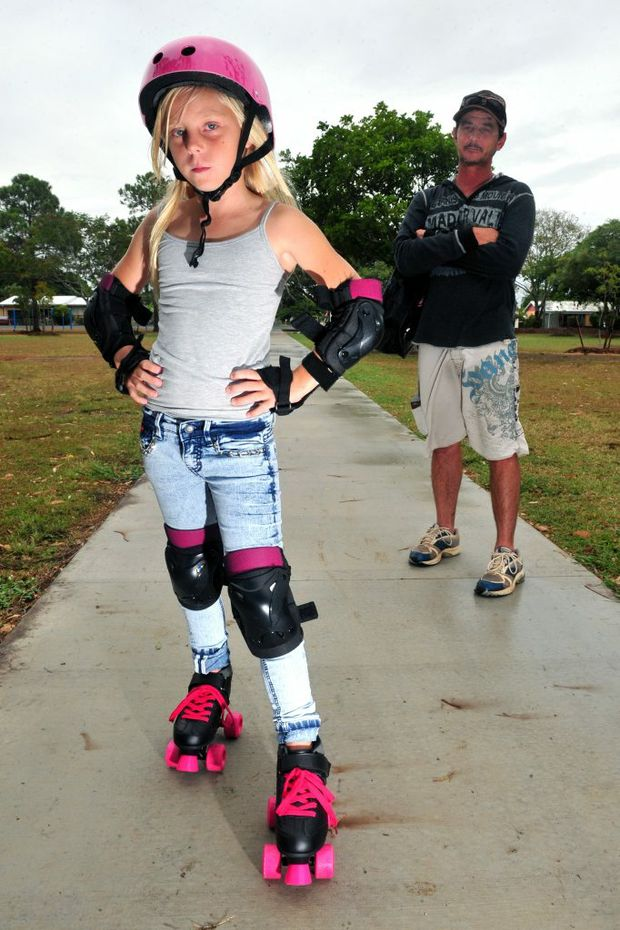 GRAFFITI GRUBS: Quinlyn Anderson-Grice and her dad Jodie Grice are disgusted by the senseless graffiti vandalism at Boreham Park which has recently been upgraded with new equipment. Photo: Max Fleet / NewsMail