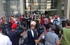 Acting Commissioner Mike Condon addresses the media outside the court.