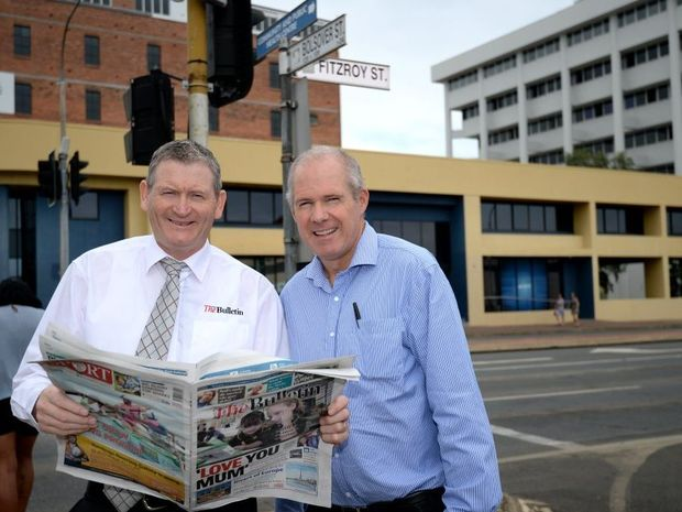 General Manager Phill Le Petit and Editor Frazer Pearce with The Morning Bulletins new home on the corner of Bolsover and Fitzroy Streets. Photo Allan Reinikka / The Morning Bulletin