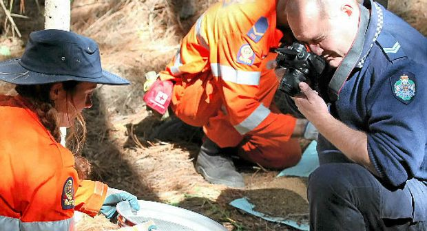 Police photographers pore over evidence during the search for the remains of Daniel Morcombe.