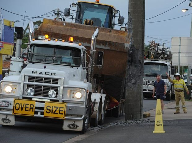 A over-sized truck carrying a front-end loader hit a power pole on Alice St in Maryborough.