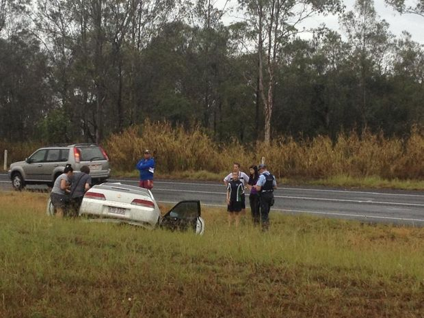 Police at the scene of a two-car crash on Saltwater Creek Rd in Maryborough.