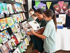 Visiting students selecting books from their favourite authors