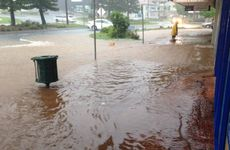 SWAMPED: The view from Yeppoon's Chemart Pharmacy as water kept rising in James St.