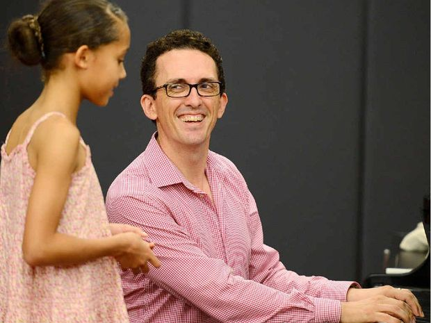 ENCOURAGING SMILE: Jason Barry-Smith gives Karana Downs nine-year-old Savannah Foran-McDaniel some tips while she auditions in Ipswich Civic Centre.