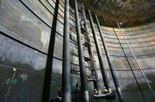 Workers carry out tests inside one of the QCLNG tanks on Curtis Island.