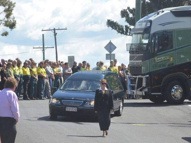 The hearse containing Terry Nolan's coffin is farewell from Gatton Catholic Church by his staff, family and friends.