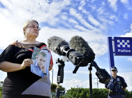 Sandy Vigar holds a photograph of her late husband Dr Martin Pearson after addressing media outside Lowood Police Station. Ms Vigar is calling for any witnesses to her husband's suspected hit and run to come forward. Lowood cyclist Dr Martin Pearson was killed while cycling near Inglewood. Photo: Claudia Baxter / The Queensland Times