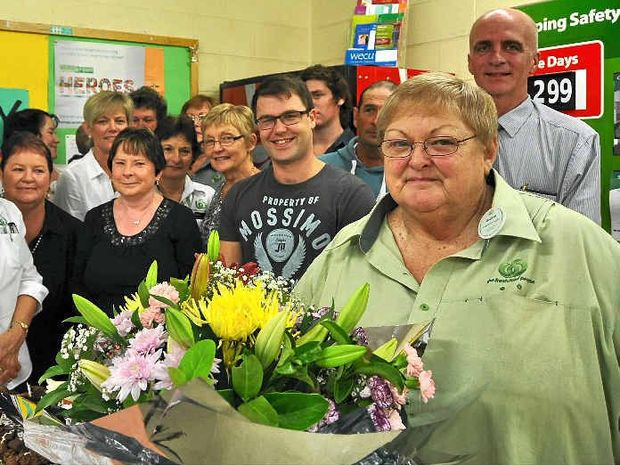 KEEPING IT FRESH: Gloria Bowles celebrates her retirement and last shift with her Woolworths colleagues.