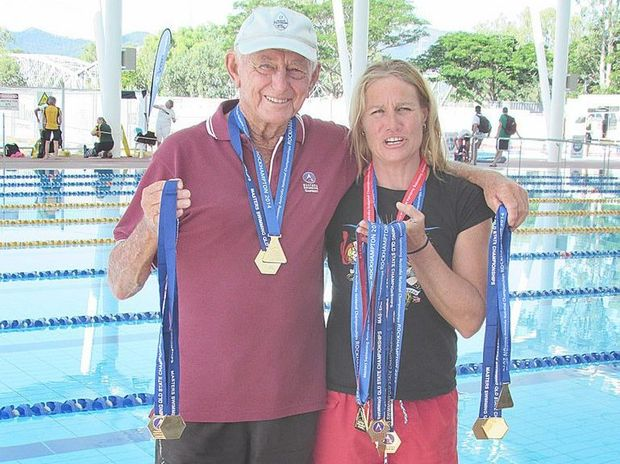 "Neville ""China"" Johnson and Lisa Bell show their 27 medals following the Australian and Queensland titles."