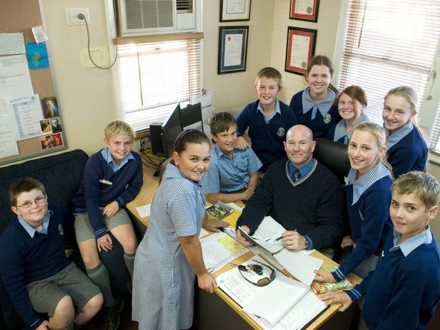 St Anthony's Primary School principal Paul Ryan attributes surviving his sixth fight with cancer to the prayers of the students of the diocese including (from left) Tommy Fechner, Flynn Gill, Abbie Rollans, Tobi Gribble, Tim Fels, Kate Neale, Genevieve Spalding, Georgia Waters, Lucy Geurtsen and Kye Hess.
