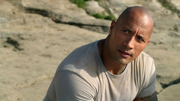 Dwayne 'The Rock' Johnson will be in the Lockyer Valley on Monday filming scenes for his new movie San Andreas. Pictured is The Rock as Hank in New Line Cinema s family adventure JOURNEY 2: THE MYSTERIOUS ISLAND, a Warner Bros. Pictures release.