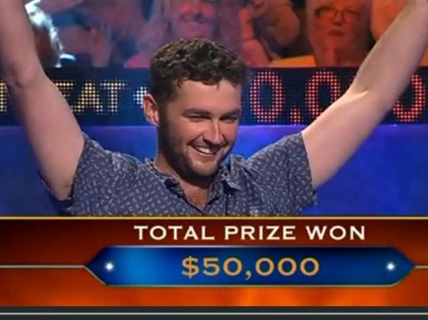 Tom Cowley celebrates his $50,000 win on Millionaire Hot Seat.