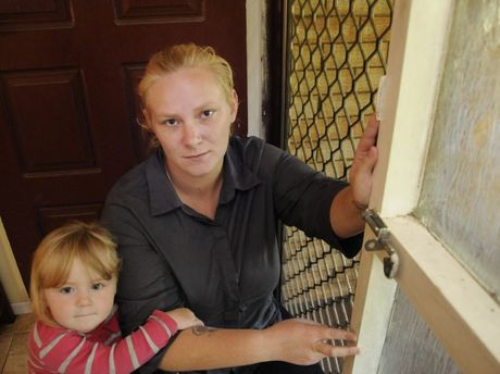 SICKENING BLOW: Tessa Kajewski and daughter Nicchia Uebergang sit beside the front door which thieves entered to steal $5500 raised for CareFlight.