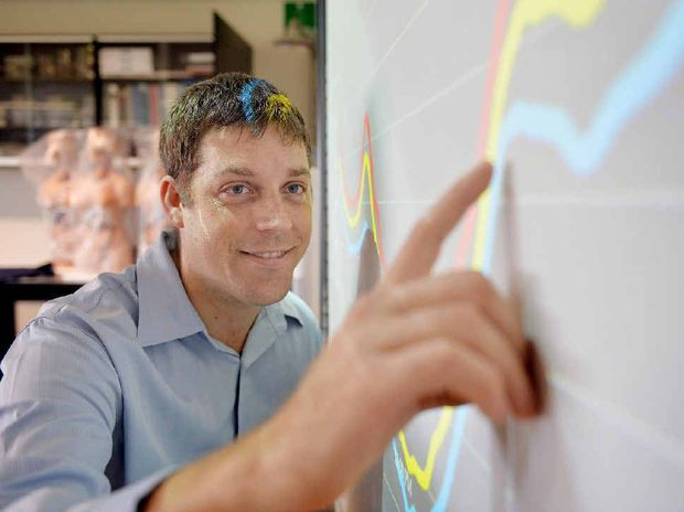 MATHS GENIUS: Aurecom electrical engineer David Croce looks closely at a powerpoint, making sense of the numbers on the board.